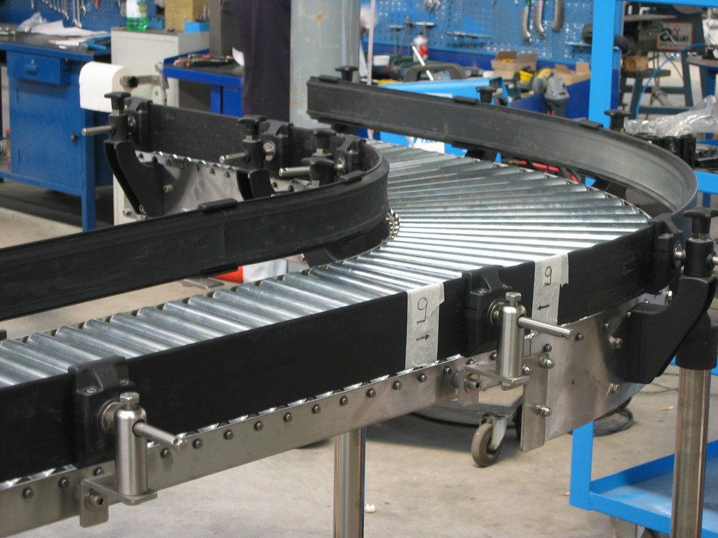 Транспортеры вертикальные и наклонные движение ленты транспортера равномерное
